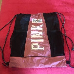 Pink drawl string backpack